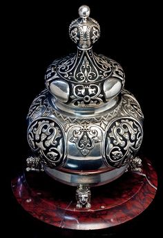 An Exceptional Faberge Silver and Enamel Inkwell, in the Russian Modern style influenced by medieval Russo-Byzantine art. The body of this large inkwell is supported by four silver lions mounted on a circular marble base. The lid is designed to resemble traditional onion-shaped domes of Russian churches.
