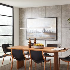 The modern, linear and architectural Planck light is featured in this sleek dining room design with light wood table and simple artwork. Provide a dramatic architectural lighting design to any space with this LED pendant. A smooth metal beam with a brushed nickel finish suspends from the ceiling to add clean visual interest to minimalist residential or commercial settings. #architectural #LED #lighting #linear #sleek #modern #modernhome #diningroom #art #simple #wood #table #artwork…