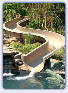 Swimming Pool Slide Ideas waterfall and slide for pool Home Water Slide Had Much Cooler Photos On The Site But Wouldnt
