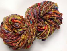 Handspun thick and thin plied mixed fibre art yarn  4.5 ozs 74 yards Garden Party