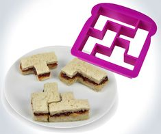 Get ready for the exciting game of sandwich now with this Tetris Sandwich Cutter. This puzzle sandwich cutter cuts your sandwiches into shapes of Tetris blocks. Naan, Sandwich Cutters, Sandwiches, Geek Stuff, Cool Inventions, Cool Gadgets, Kitchen Gadgets, Kitchen Stuff, Kitchen Things