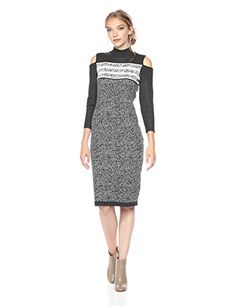 Gabby Skye Women's Turtle Neck Cold Shoulder Sweater Dress, Graphite/Ivory. Spice up your wardrobe this fall with these beautiful cable knit sweater dress women. Sweater women dresses come in many varieties including oversized sweater dresses women, short sweater dress, cowl neck sweater dresses and many more styles. These cute sweater dresses women are trendy and stylish. Look great this fall with long sweater dress women.