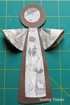 * Tutorial: Paper Angels.  Materials: •Colored card stock, •Cereal Box, •Newsprint or tissue paper, •Glue, Scissors, •Thread, •Paper Angel Template