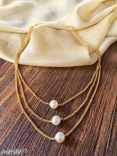 Necklaces & Chains Women's Pearl And Gold Plated Necklaces & Chains Base Metal: Alloy Plating: Gold Plated Stone Type: Pearls Sizing: Short Sizes: Country of Origin: India Sizes Available: Free Size   Catalog Rating: ★4 (7946)  Catalog Name: Twinkling Chunky Women Necklaces & Chains CatalogID_1655861 C77-SC1092 Code: 421-9428473-381