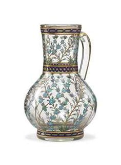 A FRENCH GILT AND ENAMELLED GLASS JUG IN THE IZNIK STYLE  SIGNED POTTIER, NICE, FRANCE, DATED 1885