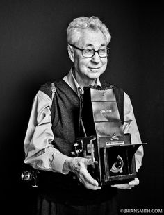 """Photographer Elliott Erwitt """"is an advertising and documentary photographer known for his black and white candid shots of ironic and absurd situations within everyday settings— a master of Henri Cartier-Bresson's """"decisive moment""""."""""""