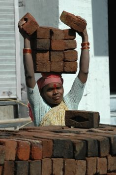 Indian women are tough - this lady is a construction worker.
