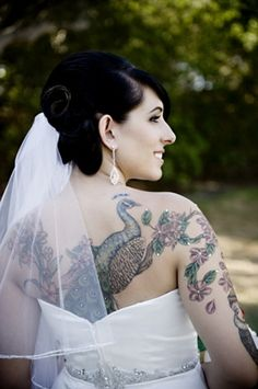 This bride put jewels on her tattoos for the wedding - what an awesome idea! #tattoo #tattooed #bride #bling #rhinestone #bejeweled