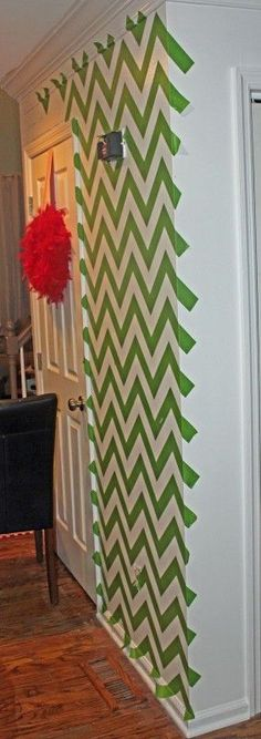 Chevron stripe painting tutorial. How to tape off a wall to create chevron or zigzag patterns on walls featured on Remodelaholic.com #Chevron #tutorial #wall