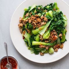 This incredibly fast pork stir-fry gets a kick from spicy chili garlic sauce and a load of nutrients from baby bok choy.