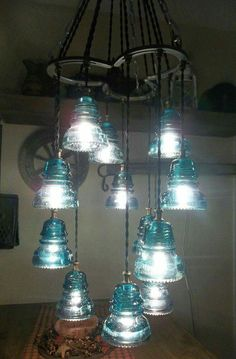 Horseshoe and vintage glass insulators chandelier Electric Insulators, Insulator Lights, Glass Insulators, Horseshoe Crafts, Horseshoe Art, Rustic Lighting, Home Lighting, Bedroom Lighting, Western Style