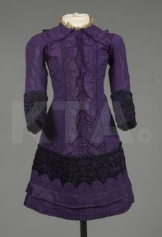 A purple taffeta and satin girl's dress, early 1880's.