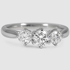 A timelessly romantic three stone design in white gold.