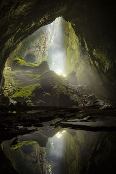 A sunbeam shines in through the first doline in Hang Son Doong, the world's largest cave.