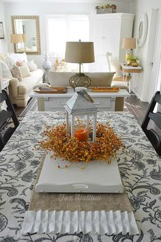 Mini cottage home tour with easy, low-stress holiday decorating ideas. Versatile lantern, layered linens, Fall wreath centerpiece..