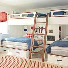 In the basement bedroom, a smart bunk system fits two queen beds and two full beds—the bottom two face out, and the top two are positioned perpendicular to them. CoastalLiving.com