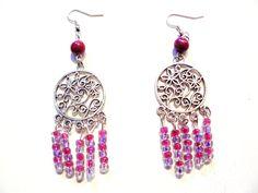 Boucles d'oreilles estampes argentées et perles de rocailles mauves et roses
