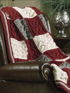 """Four squares of intricately woven cables are knit together to create larger blocks in this carry-along project; joining and borders may be worked at a leisurely pace. Instructions are given for 2 sizes. This e-pattern was originally published in Big-Needle Knit Afghans. Size: 48"""" x 61"""" and 64"""" x 79"""". Made with super bulky (super chunky) and medium (worsted) weight yarns and size 13/9mm straight and 32"""" circular needles. Skill Level: Intermediate"""