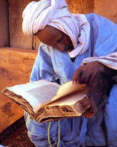 Reading a holy book - Mauritania, north Africa.