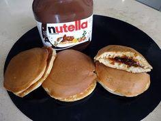 Dorayaki, pancake Giapponesi- alla Nutella -  130g di farina00 80g di zucchero Bianco 50ml di acqua 1 cucc grande di miele 1/2 cucc piccolo di bicarbonato 2 uova  Nutella/ confetture