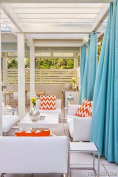 Gorgeous use of color, turquoise and orange, on the patio.  House of Turquoise: Maison de VIE