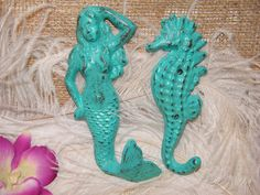 2 Wall Hooks - Sea creatures - Mermaid and Seahorse - Bright Turquoise Green - His Hers - Bathroom - Kitchen Decor - Beach House Decor. $19.99, via Etsy.