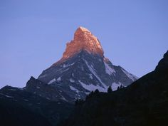 Matterhorn at sunrise,  Matterhorn Mountain, Switzerland.  Go to www.YourTravelVideos.com or just click on photo for home videos and much more on sites like this.