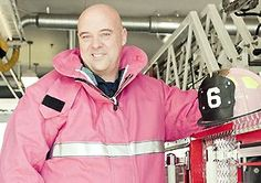 Bethesda firefighter receives pink gear in memory of sisters who died of breast cancer