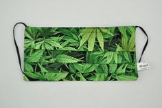 This mask features Marijuana Cannabis plants. Smoke that! All our mask are made from two layers of cotton fabric with adjustable elastic earloops. They are washable (hand wash and drip-dry only) and r