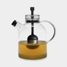 Glass Teapot with Infuser • This generously sized teapot is made of clear glass with an egg-shaped stainless-steel infuser that is easily raised by pulling the attached silicone string when the tea is ready for serving. Dishwasher-safe. • $80