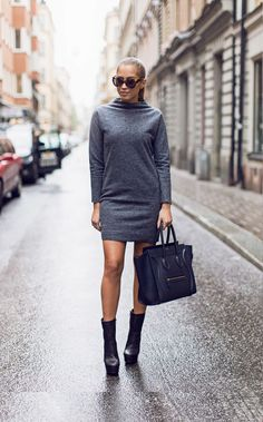 Kenza Zouiten is wearing a grey melange tunic and black platform boots from Nelly and the bag is from Céline
