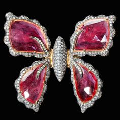 A surprising Butterfly Ring with rubies. This and more rare jewelry for sale on CuratorsEye.com