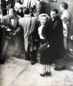 Marilyn arriving at the Actor's Studio for the Baby Doll benefit, December 4, 1956.