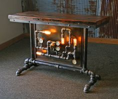 Ready to Ship - Ships in 48 Business Hours Each lamp/table has a unique serial number and signed, (serial numbers can be tracked on ourwebsite) Table number #1468 Super cool industrial table! Pipes are mounted to a pice of iron and mounted into a pipe frame Antique brass gauges and welding regulator Super cool barn wood top with metal frame These were taken from the floor boards, with heavy traffic creating crazy cool patina and character Very light satin clear coat added, keeping the...