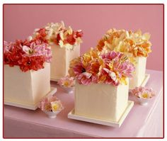 An alternative to the multi-tier cake. Lots of mini cakes topped with fresh blooms!