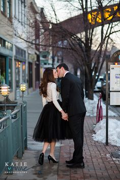 Lovely black tulle skirt and handsome black tie suit on the snowy streets of…