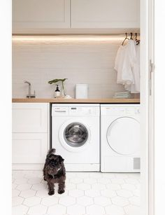 With its herringbone oak benchtop, white hexagon tiles and bagged-brick splashback, this laundry is anything but ordinary. Laundry Cupboard, Laundry Room Organization, Modern Laundry Rooms, Laundry In Bathroom, Kid Bathrooms, Ikea Laundry Room, Laundry Closet, Laundry Room Inspiration, Laundry Room Remodel