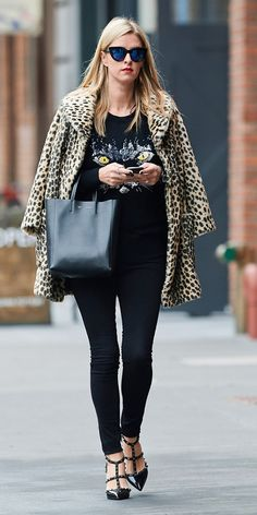 Nicky Hilton in animal print coat paired with skinny jeans, studded Valentino heels, + cat-eye sunglasses