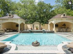 Formal pool with twin Cabanas - a Living area on the left, and an Outdoor Kitchen on the right