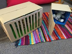 Inside out Cardboard boxes to make pet carry boxes for a Vet role-play scenario.