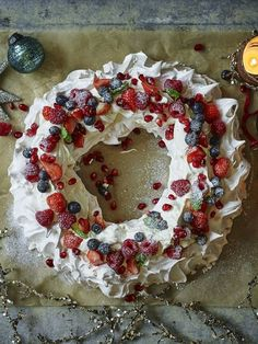 Have a Mary Berry Christmas with this easy pavlova that can be made well ahead of the festivities. Have a Mary Berry Christmas with this easy pavlova that can be made well ahead of the festivities. Christmas Pavlova, Best Christmas Desserts, Christmas Party Food, Xmas Food, Christmas Cooking, Christmas Treats, Holiday Recipes, Christmas Popcorn, Mary Berry Xmas Recipes