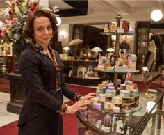 Miss Mardle, smitten by the persuasive charms of chocolatier Jean Neuhaus is inspired to help the Belgians in her own way.