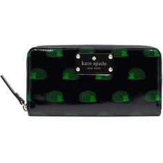 kate spade hedgehog Lacey wallet it's navy blue with green hedgehogs. this wallet is completely sold out and you can't get it anywhere. it's in almost perfect condition besides the zipper, but you could easily get that fixed. no trades, but feel free to make offers :) kate spade Bags Wallets