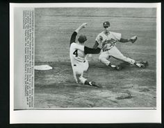 I figured the best way to start this morning was by sharing this fantastic AP action photograph of Maury Wills attempting a tag on Pirates runner Bob Skinner in 1960. Unfortunately, the throw from catcher Johnny Roseboro was far off the mark, so the outfielder slid in safely for the steal. ** Dodgers Blue Heaven: Blog Kiosk: 11/23/2015 - Dodger Links - Wills, Scully and a couple of new International Dodger Prospects