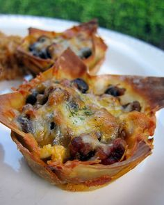 Taco Cupcakes  1 lb ground beef   1 packet taco seasoning   2/3 cup water   1 can black beans, drained   2 cups cheddar cheese, shredded   36 wonton wrappers   your favorite taco toppings - salsa, cheese, sour cream, lettuce, tomatoes, etc   cooking spread  375 for 20min.