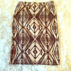 "Abstract print cream and brown pencil skirt, Tee shirt pencil skirt. Stretchy. Length: 24.5"" waist: 14"" hips: 18.5"" elastic waist. This item is used and may have imperfections. Skirts Pencil"