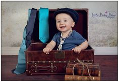 Suitcase with ties is a great idea for 8 month pics. Would get a better hat.