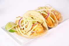 Halibut Tacos with Spicy Crema and Cabbage Slaw