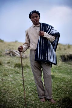 Xhosa boy wearing an Ingcawe blanket (known by the black & white stripes) which is worn by Xhosa boys before undergoing cultural rituals that mark their passage from boys to men. ph. Lavonne Bosman