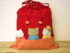 Three best friends kitties are posing in front of this large drawstring bag. Flip the kitty's hat up on the right, and you'll find a teeny-weeny pocke